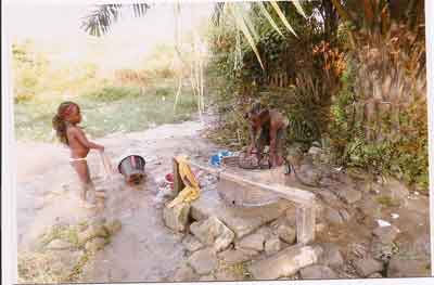 Children gathering water from Gowee Village open well